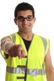 De bouwvakker die van de bouwer op u richt Stock Foto's