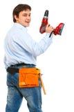 De bouwvakker met schroevedraaier kijkt terug Royalty-vrije Stock Afbeeldingen