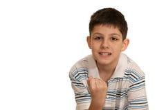 De boze jongen toont zijn vuist stock foto