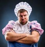 De boze mens weared als baby royalty-vrije stock afbeeldingen
