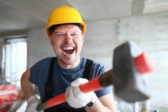 De boze voorhamer van de bouwersholding en royalty-vrije stock foto