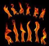 De brand van de gloed op een zwarte achtergrond stock afbeeldingen