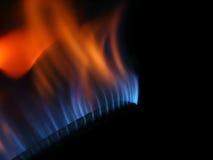 De brand van het gas die op zwarte achtergrond wordt geïsoleerdg stock foto