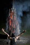 De brand van Worshiping Stock Afbeelding