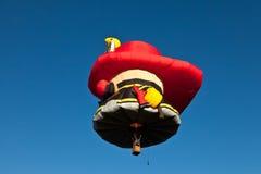 De brandweerman van de hete luchtballon Stock Afbeeldingen