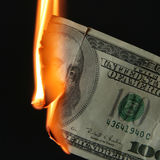 De brandwond van dollars Stock Foto