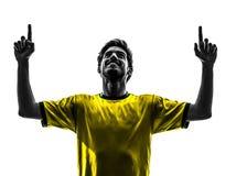De Braziliaanse mens van de het gelukvreugde van de voetbalvoetbalster jonge silhoue Stock Foto