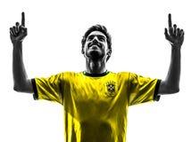 De Braziliaanse mens van de het gelukvreugde van de voetbalvoetbalster jonge silhoue Stock Foto's