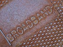 De breedband van de kabel als tekst op metaal, televisie, stock afbeeldingen