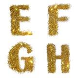De brieven E, F, G, H van gouden schitteren fonkeling op witte achtergrond Stock Afbeelding