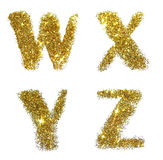 De brieven W, X, Y, Z van gouden schitteren fonkeling op witte achtergrond Stock Foto