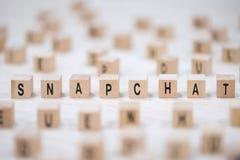 De brievenachtergrond van de Snapchat houten kubus stock afbeelding