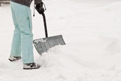 De broek van de sneeuw het scheppen stock foto