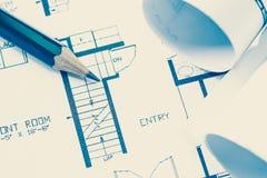 De broodjes en de plannen van de architect stock foto's