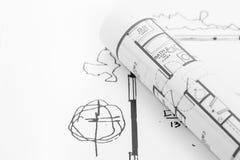De broodjes en de plannen van de architect stock fotografie