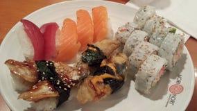 De Broodjes en de Sashimi van sushi Stock Foto's
