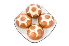 De broodjes van de voetbal op een plaat. Royalty-vrije Stock Foto's