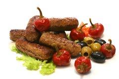 De broodjes van het vlees met olijven en peper stock foto