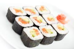 De broodjes van sushi met sashimi Stock Afbeeldingen