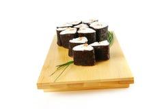 De broodjes van sushi met shnittui Stock Afbeeldingen