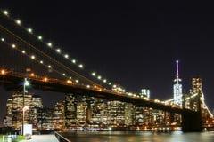 De Brug van Brooklyn en Horizon de Van de binnenstad van Manhattan Stock Afbeelding
