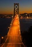 De Brug van de baai, San Francisco bij zonsondergang Royalty-vrije Stock Foto's