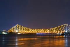 De brug van Howrah in gouden gloed Stock Fotografie