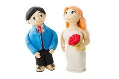 De bruid en de bruidegom maakten van koekje stock foto