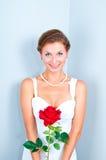 De bruid met een rood nam toe Stock Fotografie