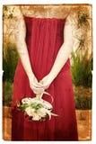 De bruid van Grunge in rode zijdekleding stock foto's