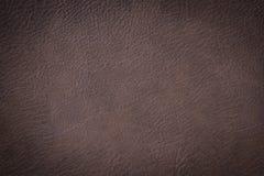 De bruine de textuurclose-up van het luxeleer kan als achtergrond worden gebruikt Royalty-vrije Stock Afbeelding