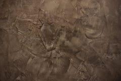 De bruine decoratieve achtergrond van de pleistertextuur Stock Foto