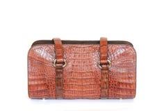 De bruine handtas van de krokodilkunstleer voor vrouw of de mens op wit Stock Afbeelding