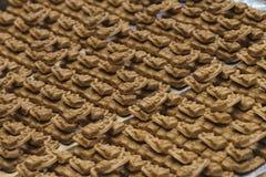 De bruine kleine beelden van Boedha Stock Fotografie
