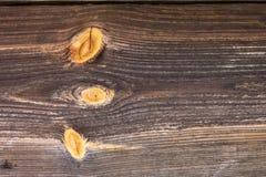 De bruine oude houten textuur met knoop stock foto's