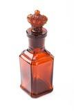 De bruine retro fles van het glas met kurkkroon Stock Fotografie