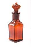 De bruine retro fles van het glas met kurkkroon Stock Foto's