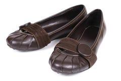 De bruine schoenen van vrouwen stock afbeeldingen