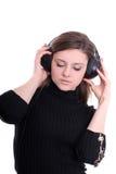 De brunette met Oortelefoons mediteert het Dansen Royalty-vrije Stock Afbeelding
