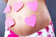 De buik van de zwangere vrouw Stock Foto