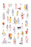 De bundel van uiterst kleine mensen kleedde zich in bovenkleding die en openluchtactiviteiten lopen uitvoeren bij Kerstmisvooravo royalty-vrije illustratie