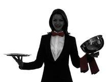 De butler van de vrouwenkelner het openen het silhouet van de cateringskoepel Royalty-vrije Stock Fotografie