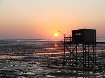 De cabine die van de visser zonsondergang vangt Stock Afbeelding