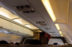 De cabine van het vliegtuig Stock Afbeeldingen