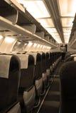 De cabine van passagiers in vliegtuigen Stock Afbeeldingen