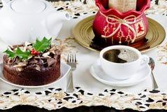De cake en de koffie van Kerstmis stock fotografie