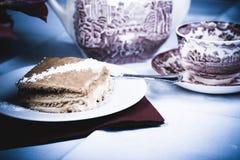 De cake en de thee van de framboos Stock Foto's
