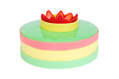 De cake van de pastelkleurverjaardag met geïsoleerde aardbei Stock Foto