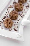 De cakes van snoepjes met chocolade Stock Afbeelding