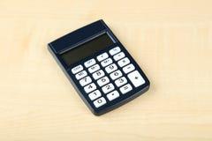 De calculator op houten achtergrond, sluit omhoog Royalty-vrije Stock Afbeelding